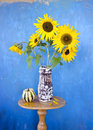 Beautiful summer sunflowers in old ceramic vase Royalty Free Stock Photo