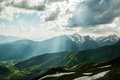 Beautiful sunlight on the top of mountain from vivid clouds caucasus Royalty Free Stock Image