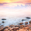 Beautiful sunrise over the rocky sea coast wonderful world Royalty Free Stock Image