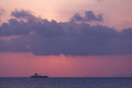 Beautiful sunset above the sea at with cargo ships in background Royalty Free Stock Photography