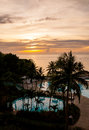 Beautiful sunset at a beach resort in the tropics Stock Image