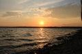 Beautiful sunset, dawn.   Coast. Beautiful sunset over the lake. Royalty Free Stock Photo
