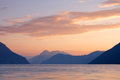Beautiful sunset landscape on fjord with at the with clouds norway Stock Photos