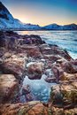 Beautiful sunset Norway landscape of picturesque stones on the arctic beach of cold Norwegian Sea Royalty Free Stock Photo
