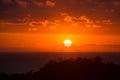 Beautiful sunset over Costa Rica. Red sky. Full disk sun