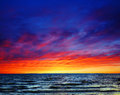 Beautiful sunset over the sea colorful wavy waters or ocean Stock Photos