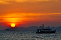 Beautiful Sunset On Sea and fishing boat Stock Photos