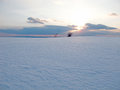Beautiful sunset at a winter snowy field in the twilight Royalty Free Stock Photo