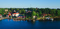 Beautiful super wide-angle aerial view of Stockholm archipelago skerries and suburbs with classic sweden scandinavian designed cot Royalty Free Stock Photo