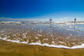 Beautiful Surf and Sand on a Summertime Ocean Beach Holiday Vacation. Royalty Free Stock Photo
