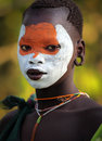 Beautiful suri woman young with face painting at a ceremony in south omo ethiopia Stock Image