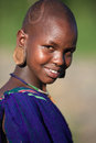 Beautiful suri woman young smiling with earring at a ceremony in south omo ethiopia Stock Photos