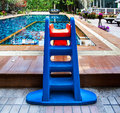 Beautiful swimming pool with tot slide.