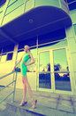 Beautiful tall fashion model posing in front of modern building Royalty Free Stock Photo