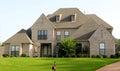 Beautiful Tan Brick and Stucco Suburban Home Royalty Free Stock Photo
