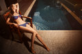Beautiful tan woman in bikini sunbathing Royalty Free Stock Image