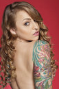 Beautiful Tattooed Woman Looki...