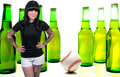 Beautiful tattooed woman young with beer and a baseball Stock Image