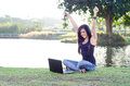 Beautiful teen enjoying technology young girl with hands up and big smile looking at her laptop Royalty Free Stock Photos