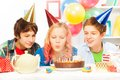 Beautiful teen girl blow cake on birthday party Royalty Free Stock Photo