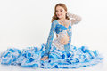 Beautiful teen girl in a blue suit oriental dance Royalty Free Stock Photo