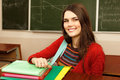 Beautiful teen girl high achiever in classroom near desk happy s over smiling Royalty Free Stock Images