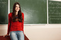 Beautiful teen girl high achiever in classroom near desk happy smiling Stock Photography