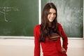 Beautiful teen girl high achiever in classroom near desk