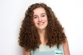 Beautiful teenage girl with curly hair smiling Royalty Free Stock Photo