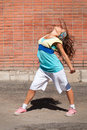Beautiful teenage girl dancing hip-hop Stock Photos