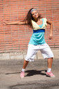 Beautiful teenage girl dancing hip-hop Stock Image