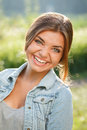 Beautiful teenage girl laughing close up portrait of outdoors looking at camera Royalty Free Stock Photography