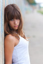 Beautiful teenage girl leaning against wall Royalty Free Stock Photo