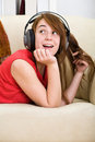 Beautiful teenage girl listening to music Stock Images