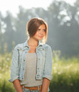 Beautiful teenage girl outdoors portrait of in jeans wear looking away Stock Photography