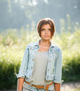 Beautiful teenage girl outdoors portrait of in jeans wear looking at camera Royalty Free Stock Photography