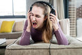 Beautiful teenage girl in pain screaming suffering from loud music Royalty Free Stock Photo