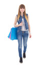 Beautiful teenage girl with shopping bags isolated on white background Stock Photo
