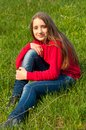 Beautiful teenage girl sitting in the grass Royalty Free Stock Photos