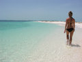 Beautiful teenage girl walking at the beach Royalty Free Stock Images