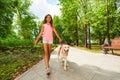 Beautiful teenage girl walking her dogs Royalty Free Stock Photo