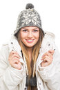 Beautiful teenage girl wearing winter jacket and knitted beanie hat posing young caucasian smiling looking at camera isolated on Stock Image
