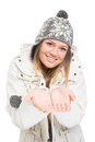 Beautiful teenage girl wearing winter jacket and knitted hat young caucasian looking at camera smiling holding hands in front of Stock Image