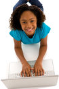 Beautiful teenage girl working on labtop african ethnicity typing computer isolated white background Stock Images