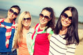 Beautiful teenage girls having fun on the beach summer holidays vacation happy people concept or young women Stock Photo