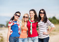 Beautiful teenage girls or young women having fun summer holidays vacation happy people concept on the beach Royalty Free Stock Images