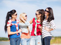 Beautiful teenage girls or young women having fun summer holidays vacation happy people concept on the beach Stock Images