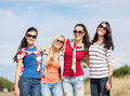 Beautiful teenage girls or young women having fun summer holidays vacation happy people concept on the beach Stock Image