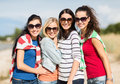 Beautiful teenage girls or young women having fun summer holidays vacation happy people concept on the beach Stock Photo
