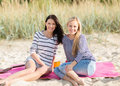 Beautiful teenage girls or young women having fun summer holidays vacation happy people concept on the beach Royalty Free Stock Photography